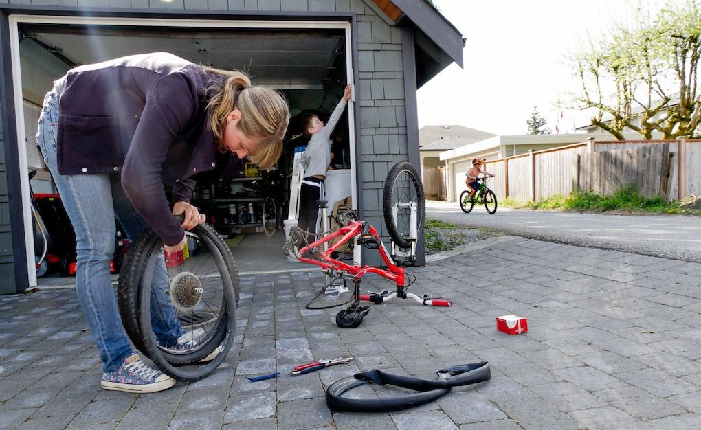 Lady Changing Bike Tube